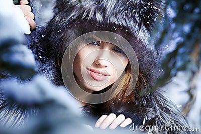 Woman in winter wood