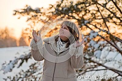 Woman on winters sunset