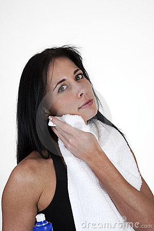 Woman Wiping Her Face With A Towel Royalty Free Stock Images - Image: 17586119