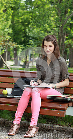 Woman Wiritng Outside in a Park