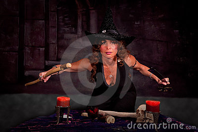 Woman in witch costume performing ritual