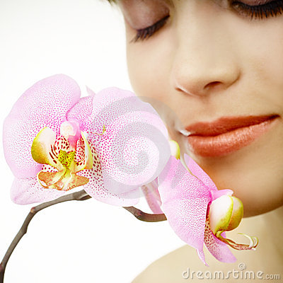 Free Woman With An Orchid - Face Close-up Royalty Free Stock Photography - 19933297