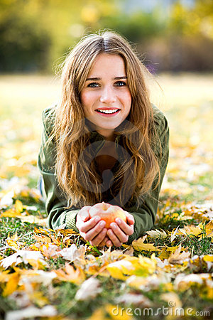 Free Woman With Apple Outdoors In Autumn Royalty Free Stock Photo - 22042135