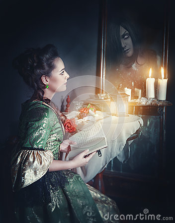 Free Woman With Book In Retro Dress And Ghost In The Mirror Royalty Free Stock Image - 66150926