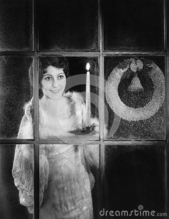 Free Woman With Candle And Christmas Wreath In Window Royalty Free Stock Image - 52000806