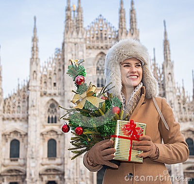 Free Woman With Christmas Tree And Gift Looking Into Distance, Milan Royalty Free Stock Images - 77410559