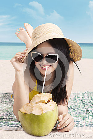 Free Woman With Coconut Fruit At Coast Stock Images - 53644884