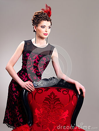 Free Woman With Fashion Hairstyle And Red Armchair Stock Photography - 30627292