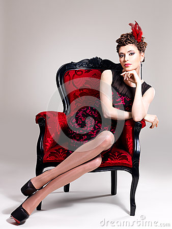 Free Woman With Fashion Hairstyle And Red Armchair Royalty Free Stock Images - 30627389