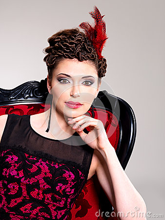 Free Woman With Fashion Hairstyle And Red Armchair Stock Photo - 30627400