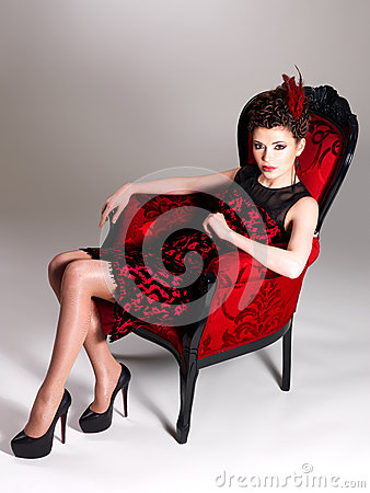 Free Woman With Fashion Hairstyle And Red Armchair Stock Images - 30627404