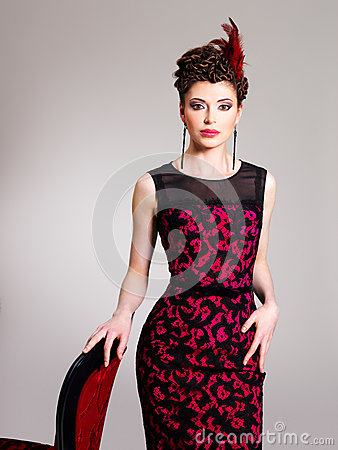 Free Woman With Fashion Hairstyle And Red Armchair Royalty Free Stock Photos - 32641488