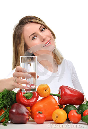Free Woman With Glass Of Pure Drinking Water And Green Vegetables And Stock Image - 69177191
