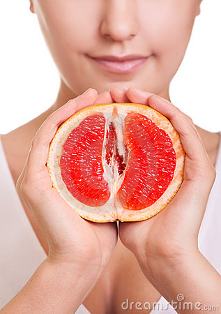 Free Woman With Grapefruit In Hands Close-up Royalty Free Stock Images - 18322169