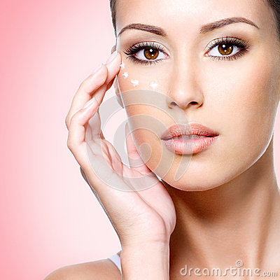 Free Woman With Healthy Face Applying Cosmetic Cream Under The Eyes Stock Photo - 36603260