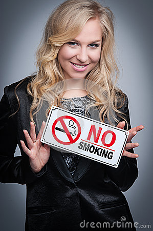 Free Woman With No Smoking Sign. Royalty Free Stock Photo - 33727055