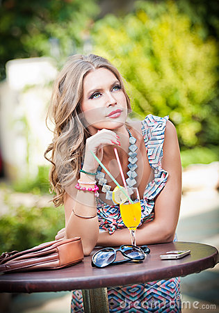 Free Woman With Orange Juice In Outside Bar Stock Photo - 28129340