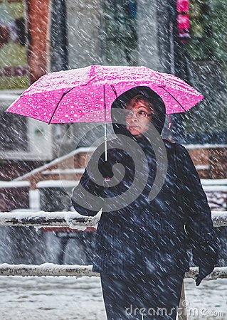 Free Woman With Pink Umbrella In Snow Royalty Free Stock Image - 110035436
