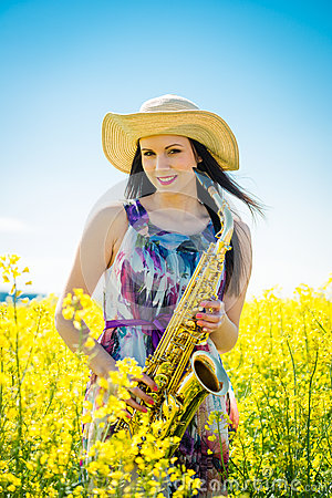 Free Woman With Saxophone In Rapeseed Field Royalty Free Stock Image - 51519526