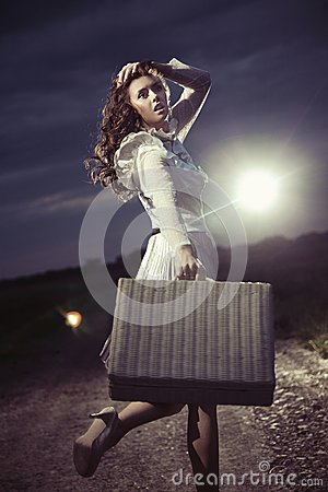 Free Woman With Suitcase Royalty Free Stock Image - 26940016
