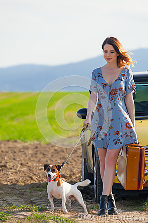 Free Woman With Suitcase And Dog Near Car Royalty Free Stock Photography - 98311477