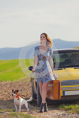 Free Woman With Suitcase And Dog Near Car Royalty Free Stock Images - 98311599