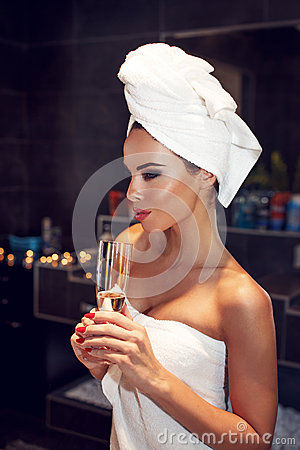 Free Woman With Towel Holding Glass Of Champagne Royalty Free Stock Image - 63658306