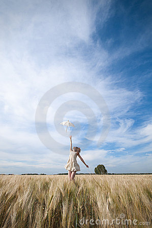Free Woman With Umbrella Walking In Field. Stock Images - 17393774