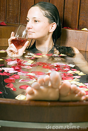Free Woman With Wine In Tub - Vertical Stock Images - 5509584