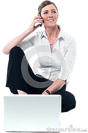 Woman woking on laptop and communicating