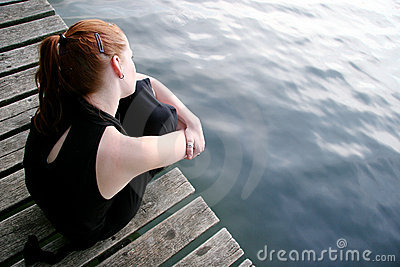 Woman wondering at lake