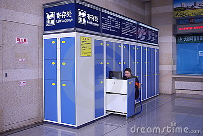 woman worker coin locker railway station Editorial Stock Image