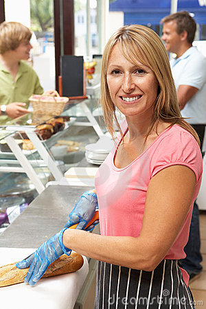Woman Working Behind Counter In Cafe