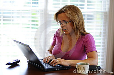 Woman working on computer at home based business