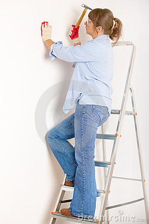 Woman working with hammer