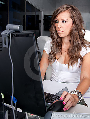 Woman working at her desk in office