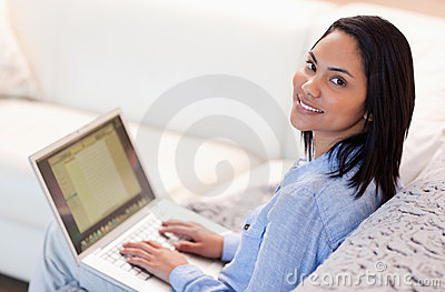 Woman working on her notebook in the living room