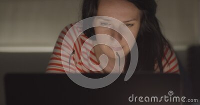Woman working late at her home office. Close up of beautiful asian woman working on her computer, very happy pose stock video footage