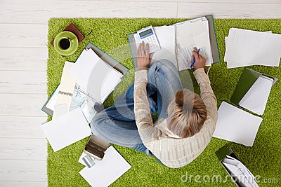 Woman working out bills