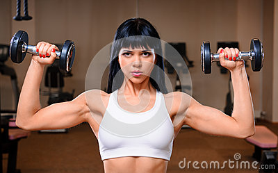 Woman working out in fitness club