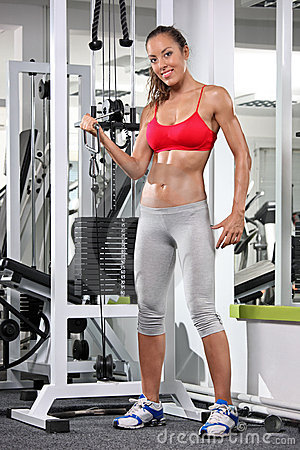 Woman working out on a fitness equipment