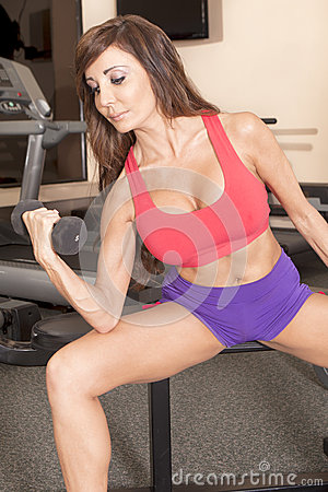Woman working out with free-weights