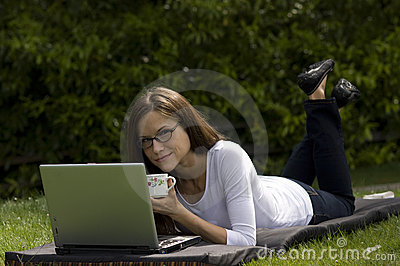 Woman Working Coffee Cup in the Park