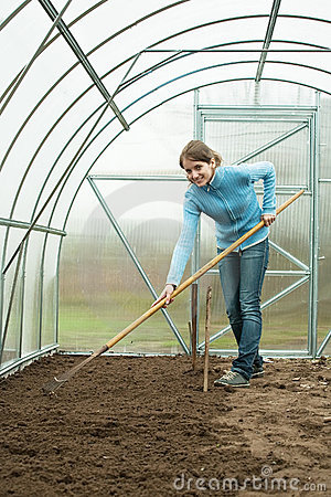 Woman working with rake