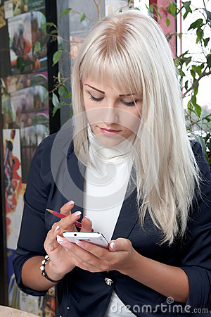 Woman working with smartphone