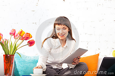 Woman working on a tablet computer