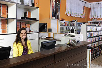 Woman working at the video rental store
