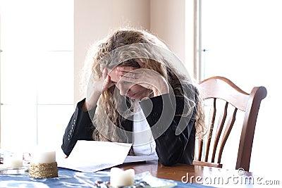 Woman worried about bills and headache