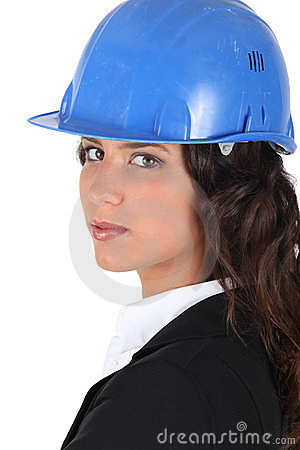 Woman wraing suit and hardhat