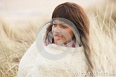Woman Wrapped In Blanket Amongst Dunes On Winter B